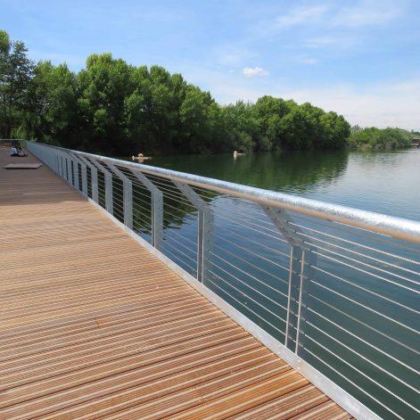 Non slip decking next to railing overlooking lake at Lakeside